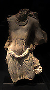Torso of a character dressed in loincloth (dhoti) from a fragment of a panel in  Kucha, south west Xinjiang, China. VI-VII century.