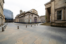Glasgow, Scotland, UK. 1 April, 2020. Effects of Coronavirus lockdown on streets of Glasgow, Scotland. Royal Exchange Square is deserted.