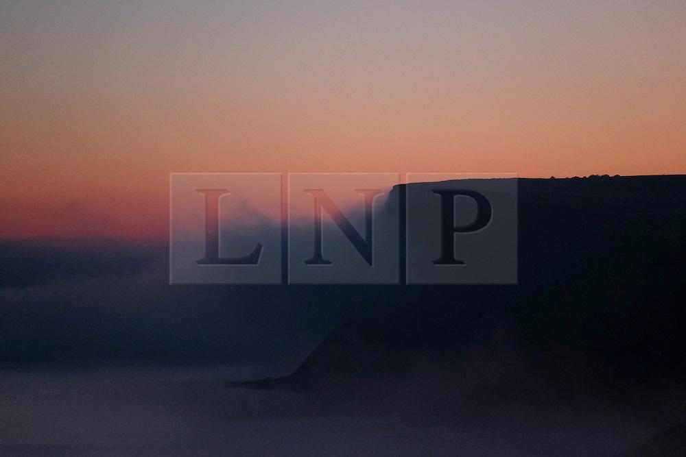 © Licensed to London News Pictures.02/11/15<br /> Saltburn, UK. <br /> <br /> Heavy fog shrouds cliffs at Huntcliff on the Cleveland coast.<br /> <br /> Photo credit : Ian Forsyth/LNP