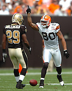 MORNING JOURNAL/DAVID RICHARD.Browns tight end Kellen Winslow signals a first down as Josh Bullocks of New Orleans looks on.