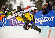 SHOT 12/12/09 12:57:37 PM - Snowboarder Danny Davis pulls a handplant in the halfpipe during finals at the U.S. Snowboarding Grand Prix in the halfpipe at Copper Mountain on Saturday December 12, 2009. Shaun White, Louie Vito and Zachary Black finished on the podium on the men's side while Kelly Clark, Gretchen Bleiler and Soko Yamaoka grabbed the top three spots on the women's side. Davis finished 13th in the event. The competition was the first of three events that will be used to select the U.S. Snowboarding Team for the upcoming Winter Olympics in Vancouver. (Photo by Marc Piscotty / © 2009)