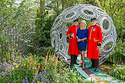 Anika Rice with Chelsea Pensioners on the Brewin Dolphin Forever Freefolk garden by Rosy Hardy - The opening day of th Chelsea Flower Show.