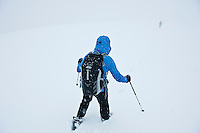 Hikers descend Fan Brycheiniog in whiteout winter conditions, Black Mountain, Brecon Beacons naitonal park, Wales