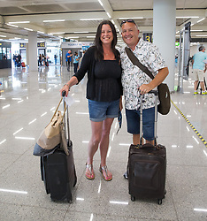 © Licensed to London News Pictures.  30/06/2021. Palma de Mallorca, Spain. Hellen and David from London arrive at Palma Airport in Mallorca as Balearic Islands are on the UK 'green list' from 4am, today. Photo credit: Marcin Nowak/LNP