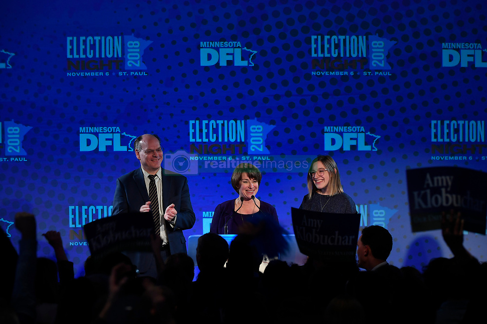 Sen. Amy Klobuchar is flanked by her husband, John Bessler, and her daughter, Abigail, during her acceptance speech at the Intercontinental Hotel in St. Paul, Minn., at DFL headquarters election party on Tuesday, November 6, 2018. Photo by Aaron Lavinsky/Minneapolis Star Tribune/TNS/ABACAPRESS.COM