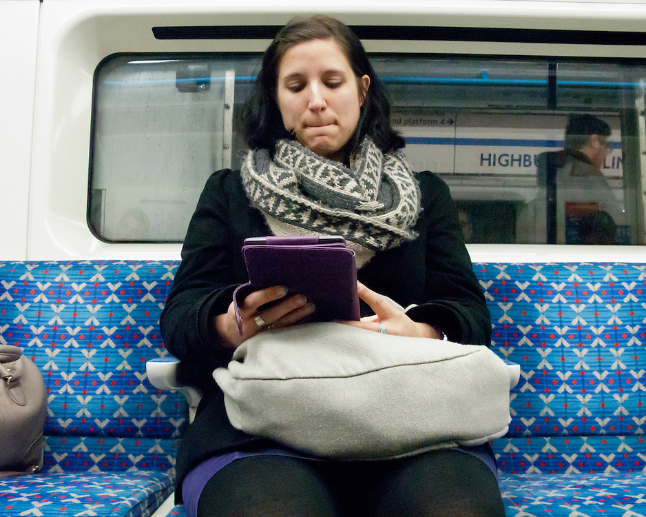 Portrait of a female Londoner on the London Underground Network reading
