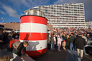 Concrete appartment blocks, visitors of the free evening concert at the Kurpromenade. Lighthouse kiosk.