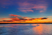 Sunset sky over ice on Lake Audy<br /> Riding Mountain National Park<br /> Manitoba<br /> Canada