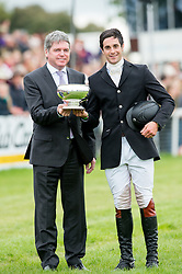 Ben Way, highest placed British rider who had not previously completed Badminton,  receives the Laurence Rook Trophy from Lance Bradley, Managing Director of Mitsubishi Motors UK<br /> Mitsubishi Motors Badminton Horse Trials - Badminton 2015<br /> © Hippo Foto - Jon Stroud