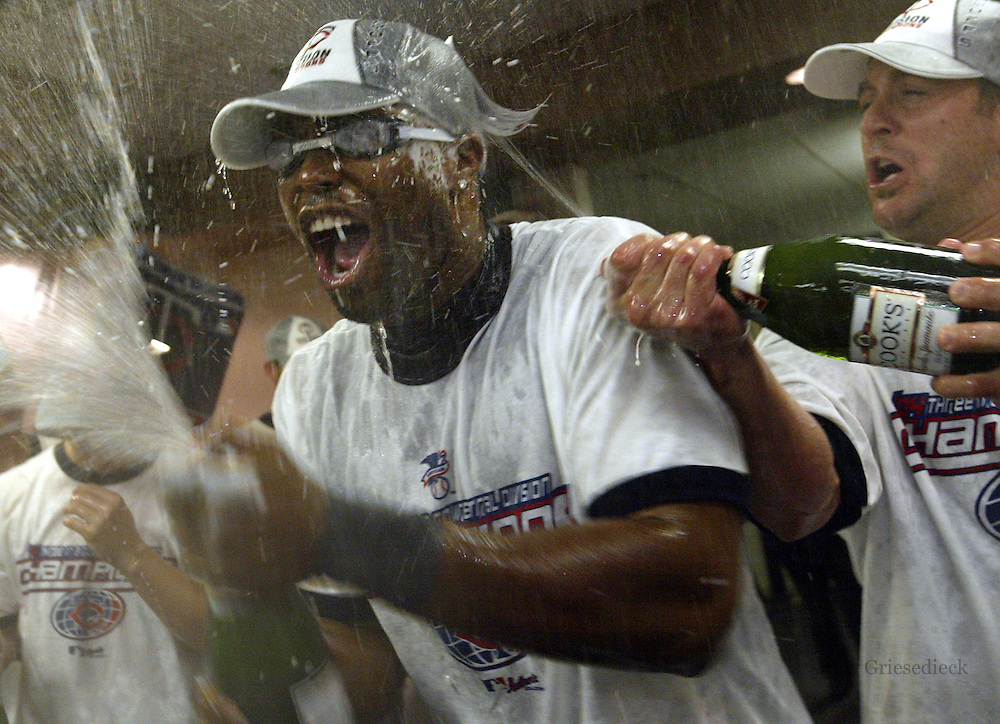 Minnesota Twins vs. Chicago White Sox in Chicago and U.S. Celuular Field. - Twins  center fielder Tori Hunter, wearing goggles, was the Twins player best prepared for the spray of champagne in the clubhouse following the team's 8-2 victory over the White Sox, which clinched the division title.