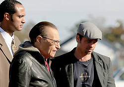 Dec 03 2007. New Orleans, Louisiana. Lower 9th Ward.<br /> Brad Pitt revisits the Lower 9th ward, devastated by Hurricane Katrina to present 'Make it Right' where architects' designs are unveiled to the public. Brad is interviewed by CNN's Larry King as they walk with 'Make it Right' director Charles Allen. Photo credit; Charlie Varley.