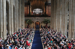 Wedding guests take their seats as they arrive for the wedding of Princess Eugenie to Jack Brooksbank at St George's Chapel in Windsor Castle.