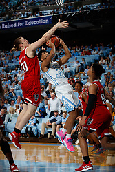 CHAPEL HILL, NC - FEBRUARY 05: K.J. Smith #30 of the North Carolina Tar Heels is pressured by Wyatt Walker #33 of the North Carolina State Wolfpack on February 05, 2019 at the Dean Smith Center in Chapel Hill, North Carolina. North Carolina won 113-96. North Carolina wore retro uniforms to honor the 50th anniversary of the 1967-69 team. (Photo by Peyton Williams/UNC/Getty Images) *** Local Caption *** K.J. Smith;Wyatt Walker