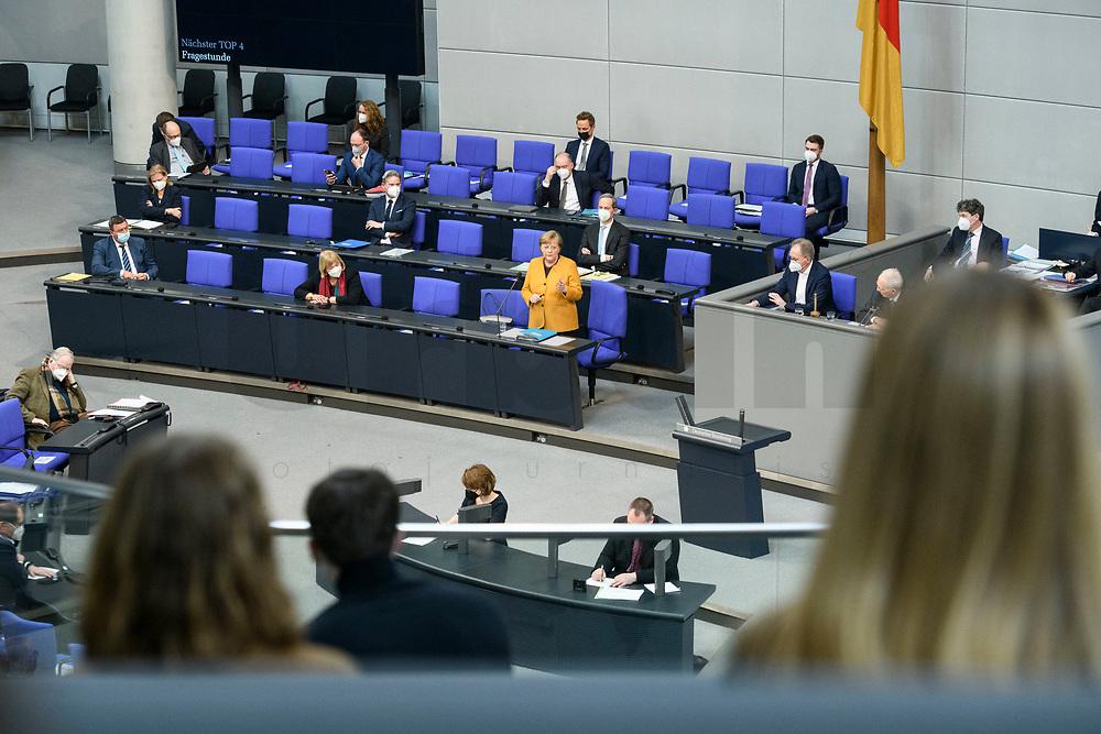 24 MAR 2021, BERLIN/GERMANY:<br /> Angela Merkel (M), CDU, Bundeskanzlerin, waehrend der Regierungsbefragung durch den Bundestag zur Bekaempfung der Corvid-19 Pandemie, Plenarsaal, Reichstagsgebaeude, Deutscher Bundestag<br /> IMAGE: 20210324-01-057<br /> KEYWORDS: Corona