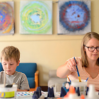 071614  Adron Gardner/Independent<br /> <br /> <br /> Ellis Ouellett, left, and his mom Lily concentrate on painting during an art party at the Expressive Arts Studio in Gallup Wednesday.