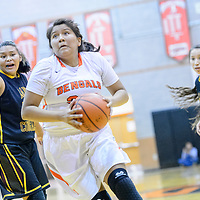 Gallup Bengal Leona Smith (33) drives to the basket to score on the Tohatchi Cougars at Gallup High School Tuesday.