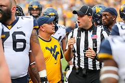 Sep 1, 2018; Charlotte, NC, USA; West Virginia Mountaineers defensive coordinator Tony Gibson talks with an official before halftime against the Tennessee Volunteers at Bank of America Stadium. Mandatory Credit: Ben Queen-USA TODAY Sports