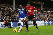 Yannick Bolasie of Everton shields the ball from Anthony Martial of Manchester United. Premier league match, Everton v Manchester United at Goodison Park in Liverpool, Merseyside on Sunday 4th December 2016.<br /> pic by Chris Stading, Andrew Orchard sports photography.