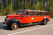 """The Historic Red Bus of Glacier National Park (in Montana, USA) was built on 1930s chassis by the White Motor Company, then rebuilt in 2001 to run on propane. A fleet of these vintage motor coaches provide tours and shuttle services in the park. I highly recommend using public transportation, as park traffic can be very heavy over Going to the Sun Road. A """"Jammer"""" (driver) drives the """"Red"""" (bus). Since 1932, Canada and USA have shared Waterton-Glacier International Peace Park, which UNESCO declared a World Heritage Site (1995) containing two Biosphere Reserves (1976). Published by National Geographic Children's Books 2011: """"Ultimate Weird But True."""""""