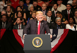June 16, 2017 - Miami, Florida, U.S. - President DONALD TRUMP gives a speech about his new Cuba policy at the Manuel Artime Theater in Miami, where he unveiled the changes he's making to the Obama-era policies toward Cuba. Trump announced changes in the policy that will put back in place some travel restrictions that were lifted under the Obama administration.  (Credit Image: © Mike Stocker/TNS via ZUMA Wire)