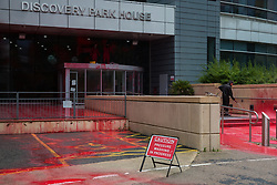 Sandwich, UK. 4th October, 2021. A man uses a pressure hose to wash red paint from Discovery Park House after it was occupied and sprayed by Palestine Action activists in protest against the presence in Discovery Park of an Instro Precision factory. Instro Precision is a subsidiary of Elbit Systems, Israel's largest publicly-traded arms company which markets drones used extensively by the Israeli military in Gaza as 'battle-proven', and it supplies 'high precision military equipment'. Palestine Action contends that equipment sold by Instro Precision has been used by the Israeli military against the civilian population of Gaza.