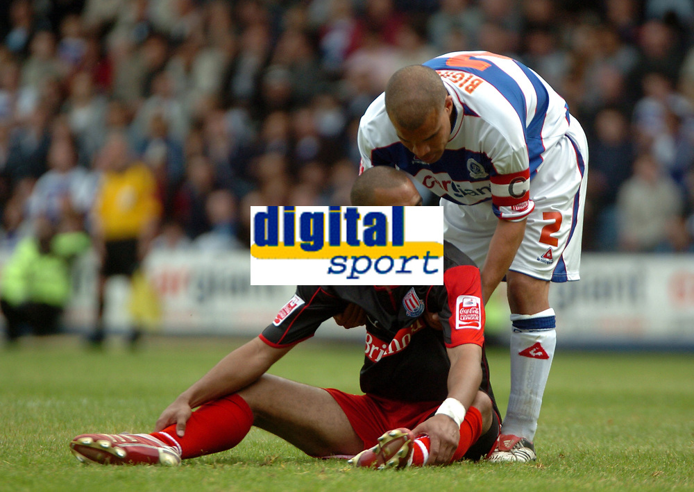 Photo: Tony Oudot.<br /> Queens Park Rangers v Stoke City. Coca Cola Championship. 06/05/2007.<br /> Marcus Bignot of Queens Park Rangers comforts Jonathan Fortune of Stoke at the end of the match