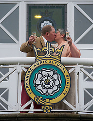 © Licensed to London News Pictures. 10/07/2012..Harrogate, England...Yorkshire born sheep handler Anne Duckworth marries fiancé and fellow sheep handler Kevin Robinson in a private ceremony at the Pavilions of Harrogate on the opening day of the Great Yorkshire Show...England's premier agricultural show opened it's gates today for the start of three days of showcasing the best in British farming and the countryside...The event, which attracts over 130,000 visitors each year is the 154th show and displays the cream of the country's livestock and offers numerous displays and events and gives the chance to see many different countryside activities...Photo credit : Ian Forsyth/LNP