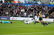 Bafetimbi Gomis of Swansea city © appeals for a penalty in the 1st half as he claims to have been brought down by Arsenal goalkeeper Petr Cech (l). Barclays Premier league match, Swansea city v Arsenal  at the Liberty Stadium in Swansea, South Wales  on Saturday 31st October 2015.<br /> pic by  Andrew Orchard, Andrew Orchard sports photography.