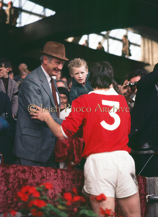 The Cork captain Martin O'Doherty shaking hands with members in the crowd after receiving the Liam MacCarthy Cup after the All Ireland Senior Hurling Final, Cork v Wexford in Croke Park on the 4th September 1977. Cork 1-17 Wexford 3-8.