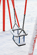Snow covered swings