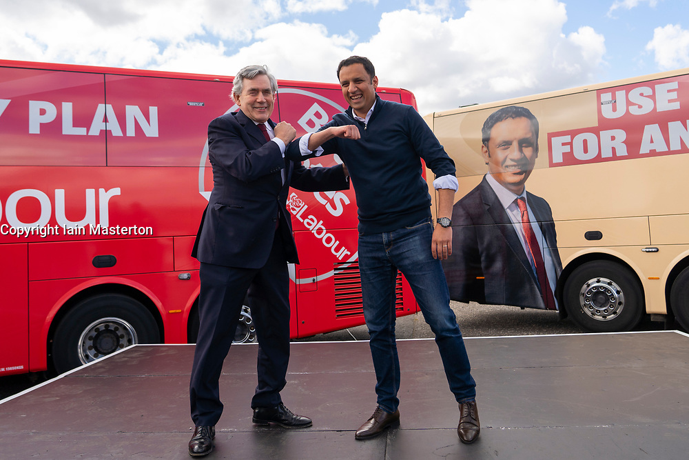 Glasgow, Scotland, UK. 5 May 2021. Scottish Labour Leader Anas Sarwar and former Prime Minister Gordon Brown appear at an eve of polls drive-in campaign rally in Glasgow today. Gordon Brown and Anas Sarwar bump elbows.  Iain Masterton/Alamy Live News
