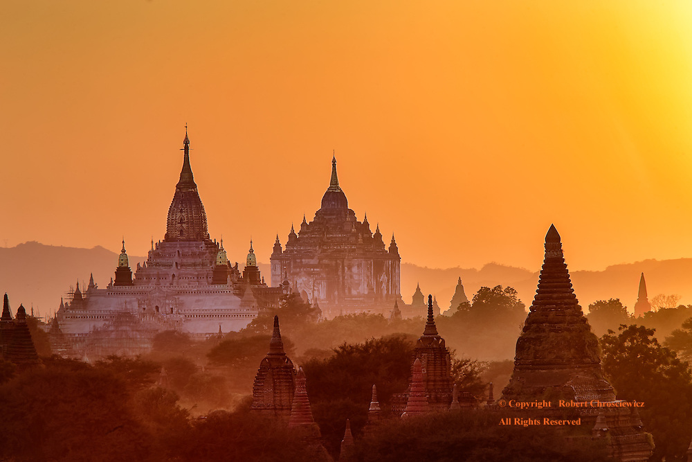 Temples Amongst the Ruins: Golden light of sunset caresses the arid landscape, its' ruins, as well as the prominent Ananda and Thatbyinnyu Temples of Bagan Myanmar.