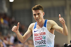 Great Britain's Chris O'Hare gives the thumbs up after winning silver in the Men's 3000m during day two of the European Indoor Athletics Championships at the Emirates Arena, Glasgow.