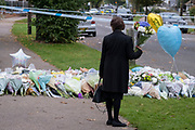 Two days after the killing of the Conservative member of parliament for Southend West, Sir David Amess MP, floral tributes are left in Eastwood Road North, a short distance from Belfairs Methodist Church in Leigh-on-Sea, on 17th October 2021, in Leigh-on-Sea, Southend , Essex, England. Amess was conducting his weekly constituency surgery when attacked with a knife by Ali Harbi Ali.