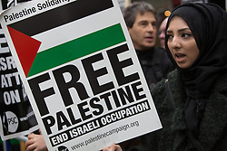 © Licensed to London News Pictures. 18/01/2014. London, UK. Demonstrators led by the Palestine Solidarity Campaign (PSC) hold a protest vigil opposite the Israeli Embassy in Kensington, London today to mark five years from the end of the Gaza War on 18 January 2009. Protestors are campaigning to end the ongoing siege on Gaza and for the justice of victims from the Gaza War. Photo credit : Vickie Flores/LNP