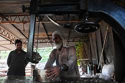 August 27, 2017 - Rawalpindi, Punjab, Pakistan - workers cut wooden blocks used for chopping sacrificial animals meat in to smaller pieces at workshop in rawalpindi (Credit Image: © Zubair Abbasi/Pacific Press via ZUMA Wire)