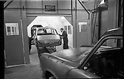 03/02/1964<br /> 02/03/1964<br /> 03 February 1964 <br /> Lincoln and Nolan new car assembly shop, East Road, East Wall, Dublin. The line was built specially for the assembly of the new Austin 1100. Image shows workers assembling the cars.