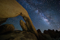 Normally I like to explore a location during the day before taking pictures there at night. But the Southern California traffic robbed me of the time to do that here. Arch Rock was a little bit hard to find in the dark, but it wasn't too bad. I just had to be careful to avoid rattlesnakes. The 30 foot long arch is located near the White Tank campground in Joshua Tree National Park. The eastern part of the park has very dark skies the farther you get from the desert cities. To illuminate the scene, I shined my headlamp on the rock wall opposite the arch. A soft, warm light was reflected backwards. I was grateful the skies cleared up long enough to see the milky way. A few minutes after this clouds started to cover the sky as monsoon thunderstorms moved past the area.<br />