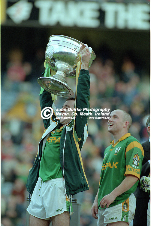 26-09-1999. Meath v Cork - All-Ireland SFC Final at Croke Park.<br /> Hank Traynor raising the Sam Maguire Cup.<br /> Photo: John Quirke / www.quirke.ie<br /> ©John Quirke Photography, 16 Proudstown Road, Navan. Co. Meath. (info@quirke.ie / 046-9028461 / 087-2579454).