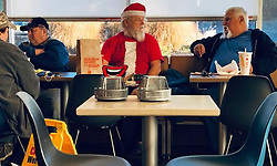 December 17, 2018 - Green Township, Ohio, USA - Santa has Some eats and chat with the Boys before heading pack to work on Mon 12-17-2018 in Green Township, Ohio at Mc Donald's in the Cincinnati area. (Credit Image: © Ernest Coleman/ZUMA Wire)