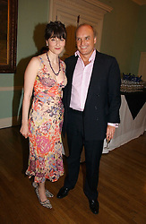 NICHOLAS & GEORGIA COLERIDGE at a party to celebrate the publication of 'A Much Married Man' by Nicholas Coleridge held at the ESU, Dartmouth House,  37 Charles Street, London W1 on 4th May 2006.<br />