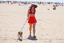 © Licensed to London News Pictures. 30/05/2021. Formby,UK. Caroline from Manchester walks with her dog as she enjoys the hot weather on Formby Beach. Photo credit: Ioannis Alexopoulos/LNP