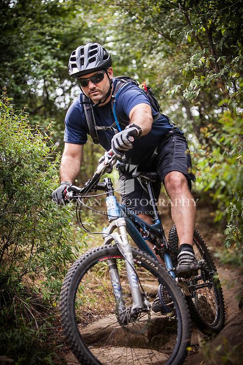 Photos of Rob Berube trail biking on Richmond's Belle Isle