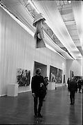 11/11/1967<br /> 11/11/1967<br /> 11 November 1967<br /> ROSC Art Exhibition 1967.<br /> John Latham standing under his exhibit Soft Skoob 1966 hung at the ROSC exhibition at the Royal Dublin Society, Dublin.