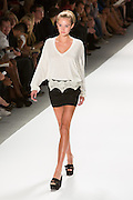 Black mini-skirt with lace at the waist, and a white top. By Zang Toi, shown at his Spring 20132 Fashion Week show in New York.
