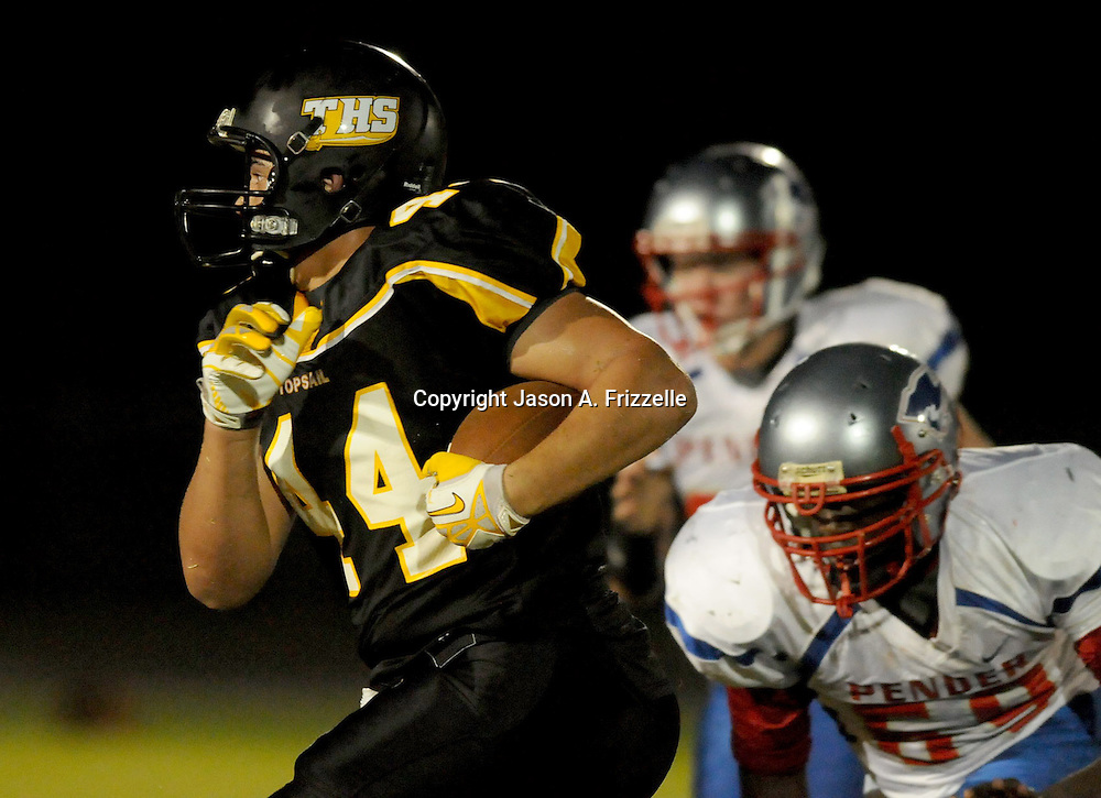 Topsail High School's Josh Jessup rushes against Pender High School's Charlie Peel Friday August 30, 2013 at Topsail High School. (Jason A. Frizzelle) This collection of images is from the 2013 High School Football in the Cape Fear region.
