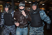 Moscow, Russia, 15/12//2010..Riot police arrest a Russian nationalist near Kievsky railway station, where police detained up 1,000 people during an operation to prevent ethnic riots. There were scuffles as hundreds of riot police were deployed to prevent clashes between Russian nationalists and traders from the Caucasus, many of whom work at a market near the station.