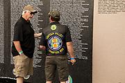 Visitor at the miniature Vietnam War Memorial.
