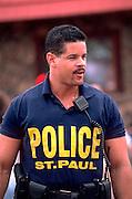 Police officer age 33 at Cinco De Mayo Festival.  St Paul Minnesota USA