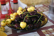 Turkey July 21 2011: Fresh white and red cherries in a bowl at Öz?afak Pension.  Copyright 2011 Peter Horrell